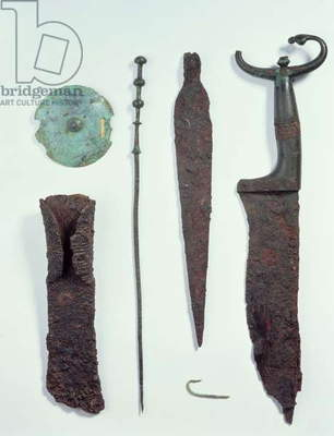 Top to Bottom: Knife, Spearhead, fishhook, clothes pin, belt disc and axe, all found in male graves at Hallstatt, Iron Age