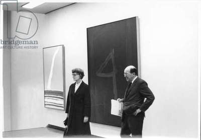Anne Truitt and Clement Greenberg in front of paintings by Robert Motherwell, Tokyo, Japan, 1966-67 (b/w photo)