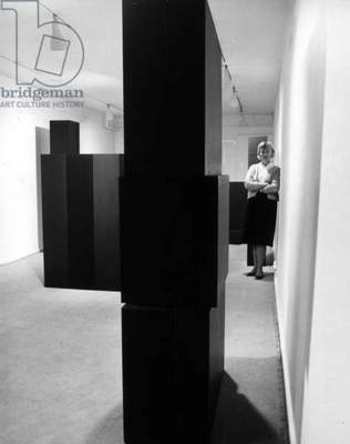 Anne Truitt pictured with sculptures at the Andre Emmerich Gallery, New York, 1963 (b/w photo)