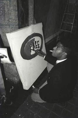 Jean-Michael Basquiat painting 'Pree' at Area, New York, 1985 (b/w photo)