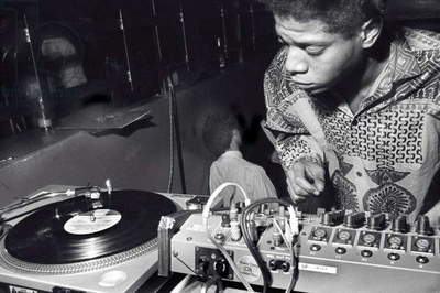 Jean-Michel Basquiat DJing at Area, New York, 1985 (b/w photo)