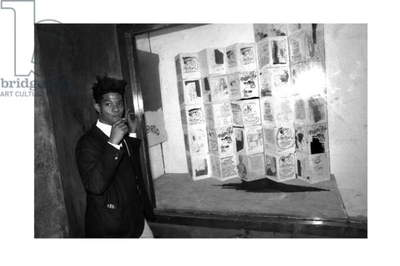 Jean-Michel Basquiat in front of his window, Area, New York, 1985 (b/w photo)