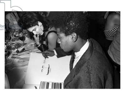 Jean-Michel Basquiat and Elizabeth Saltzman with 'snow pea' art at Mr Chow, New York, 1985 (b/w photo)