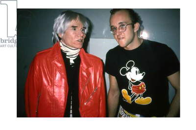 Andy Warhol and Keith Haring in front of Warhol's 'Invisible Sculpture', Area, New York, 1985 (photo)