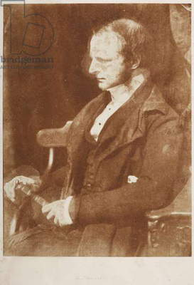 Half-length seated portrait of Rev. James Scott (c. 1800-1864), in left profile, holding a book in his lap. A portrait from a volume of calotype images and portraits. Early photographic technique also called Talbotype.