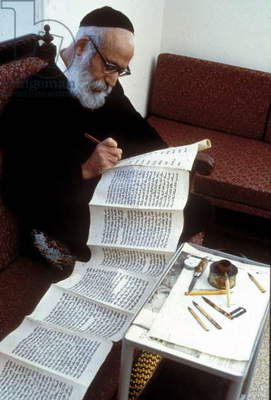 The Torah scroll being written by hand (photo)