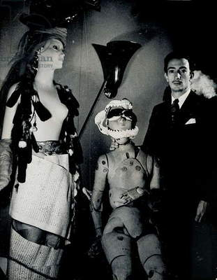 Salvador Dali with mannequins at the Surrealist Exhibition, Paris, 1938 (b/w photo)