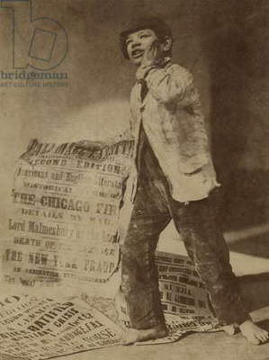 Posed image of a newsboy crying out the news of the Chicago Fire of 1871, 1871 (b/w photo)