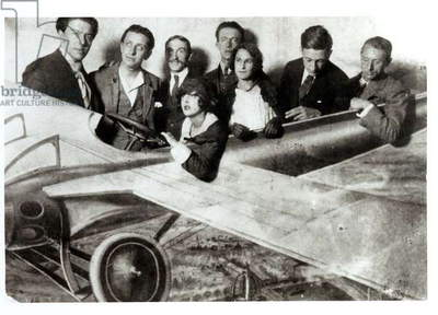 The Surrealist group in a plane in an amusement park. L-R: Andre Breton (1896-1966), Robert Desnos (1900-45), Joseph Delteil (1894-1978), Simone Breton, Paul Eluard (1895-1952), Gala Eluard (1894-1982), Jacques Baron (b.1905), Max Ernst (1891-1976) (b/w photo)