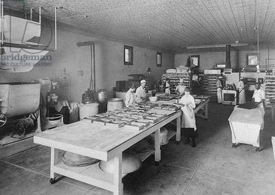 Women working in a bakery (b/w photo)