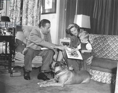 HUMPHREY BOGART AND LAUREN BACALL, 1951 Hollywood At home, Humphrey Bogart and Lauren Bacall with his son Stephen (b/w photo)