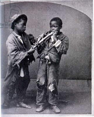 Staged photo of Black boys fighting over sugar cane 1860s-70s