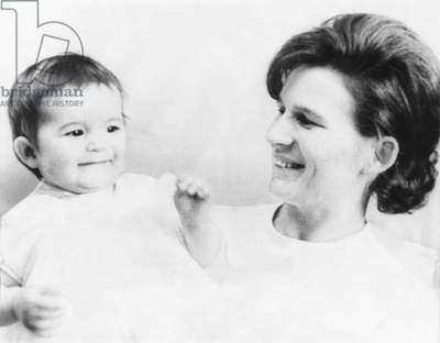 Russian cosmonaut Valentina Nikolayeva-Tereshkova with her one-year-old daughter, Alyenushka. Valentina married cosmonaut Adrian Nikolayeva shortly after she became the first woman to be launched into space. Valentina became a prominent member of the Communist Party of the Soviet Union, and remained politically active following the collapse of the USSR in 1991