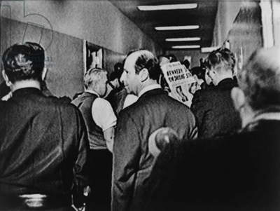 Jack Ruby, (1911-1967), center, in the crowded hall at police headquarters in Dallas, Texas after the assassination of President Kennedy on Nov. 22, 1963. Two days later he would kill suspected assassin Lee Harvey Oswald in the same building