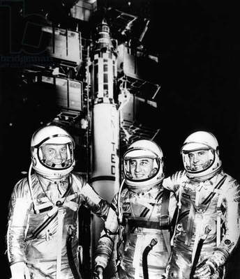 John Glenn, Virgil Grissom, and Alan Shepard, superimposed over a Mercury Redstone Spacecraft, May 4, 1961