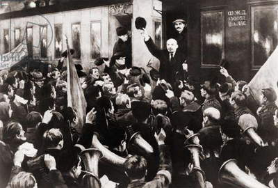 Vladimir Lenin (1870-1924), waving to crowd from train in St. Petersburg during the Russian Revolution. c. 1917