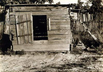 Chicken coop on the farm of Floyd Burroughs, cotton sharecropper, Hale County, Alabama. Published in the book, 'Let Us Now Praise Famous Men'. photograph by Walker Evans, 1936