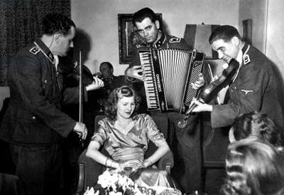 SS musicians play to Eva Braun at her sister's wedding. c. 1945