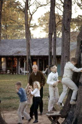 Mercury astronaut John Glenn in front of his house in Ohio with his and astronaut Scott Carpenter's children, 1965