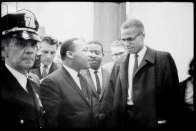 Martin Luther King Jr., and Malcolm X, waiting for press conference, 1964