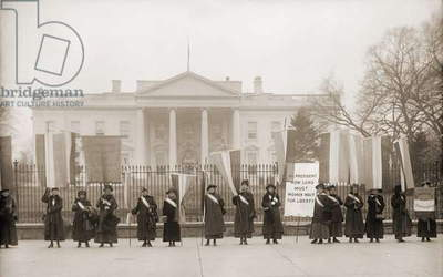 National Women's Party demonstration in front of the White House in 1918. The banner protests Wilson's failure to support women's suffrage