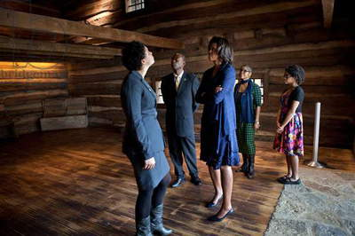 First Lady Michelle Obama in the Slave Pen exhibit at National Underground Railroad Freedom Center. Cincinnati, Ohio, Feb. 23, 2012. Built in the early 1800s, the holding pen of Kentucky slave trader, Capt. John W. Anderson. It was used to hold enslaved people to be sold south in the internal slave trade in America