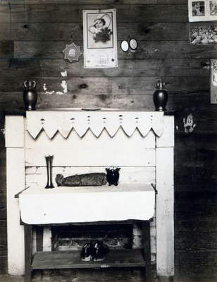 Fireplace in the bedroom of Floyd Burroughs, cotton sharecropper, Hale County, Alabama. Hale County, Alabama. Published in the book, 'Let Us Now Praise Famous Men'. photograph by Walker Evans, 1936