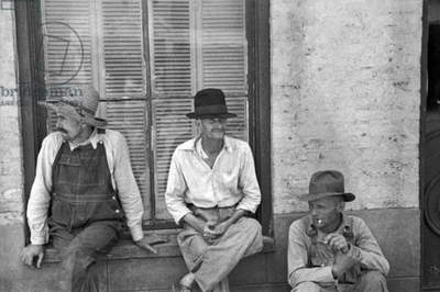 Frank Tengle, Bud Fields, and Floyd Burroughs, cotton sharecroppers. Hale County, Alabama. Published in the book, 'Let Us Now Praise Famous Men'. photograph by Walker Evans, 1936