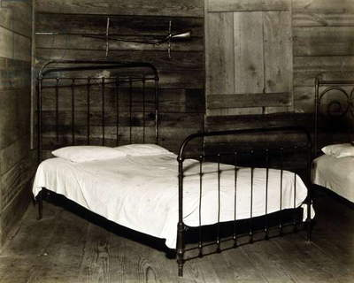 The bedroom of Floyd Burroughs, cotton sharecropper, Hale County, Alabama. Hale County, Alabama. Published in the book, 'Let Us Now Praise Famous Men'. photograph by Walker Evans, 1936