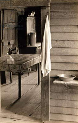 A washstand in the dog run and view into the kitchen in the home of Floyd Burroughs, cotton sharecropper. Hale County, Alabama. Published in the book, 'Let Us Now Praise Famous Men'. photograph by Walker Evans, 1936