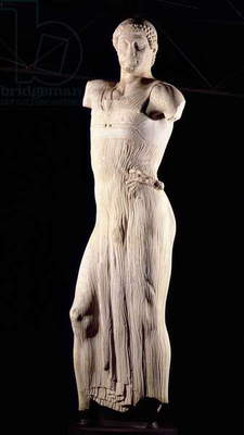 Youth clad in tight long-fitting tunic, 5th century BC (marble)