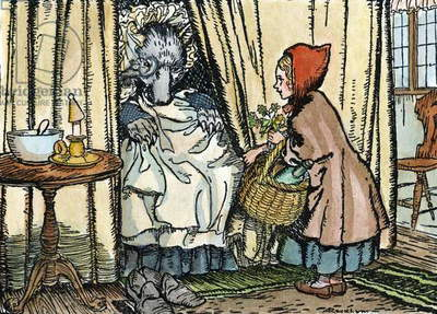 LITTLE RED RIDING HOOD Little Red Riding Hood with the wolf, disguised as her grandmother. Illustration by Arthur Rackham (1867-1939), c.1909.