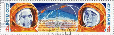 SOVIET COSMONAUTS, 1960s Valery Bykovsky (1934-), cosmonaut of Vostok 5, and Valentina Tereshkova (1937-), cosmonaut of Vostok 6 and first woman in outer space. Soviet postage stamps, 1960s.