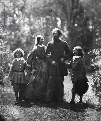 ALFRED TENNYSON (1809-1892) 1st Baron Tennyson. English poet. Lionel, Emily, Alfred and Hallam Tennyson at Farringford, England, c.1862-64. Photographed by Oscar Gustav Rejandler or Lewis Carroll.