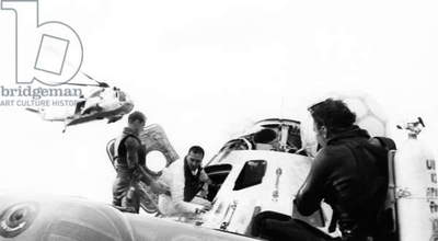 APOLLO 13: RECOVERY, 1970 Astronaut Jack Swigert exiting the Apollo 13 Command Module and entering a life raft after splashdown. Photograph, 17 April 1970.