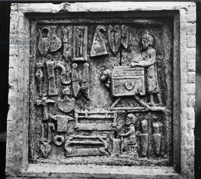 ROMAN RELIEF: SHOP Roman tomb relief depicting a hardware shop with a display of various tools, from the necropolis of Isola Sacra, near Ostia, 2nd-4th century A.D.