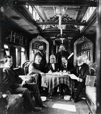 RAILROAD DIRECTORS, c.1868 The directors of the Union Pacific Railroad in a private car. Second from left, seated: Silas Seymour, Sidney Dillon, Thomas Clark Durant, and John Duff. Photograph by A.J. Russell, c.1868.