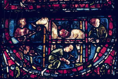 BLACKSMITHS GUILD, 13th C Members of the Blacksmiths Guild: stained glass window, 13th century, Chartres Cathedral.