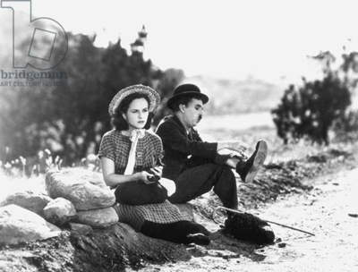 MODERN TIMES, 1936 Charlie Chaplin (1889-1977) and Paulette Goddard (1911-1990) in