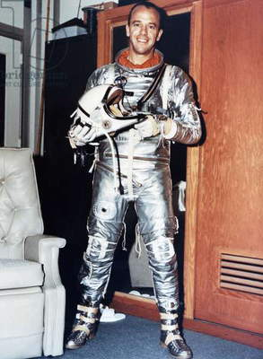 ALAN SHEPARD (1923-1998) American astronaut. Photographed wearing a parachute, 1961.