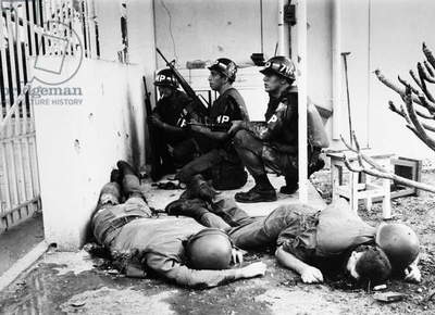 VIETNAM WAR: TET OFFENSIVE American Military Police protecting the U.S. Consulate, next to the U.S. Embassy in Saigon, against a Viet Cong attack on the Embassy compound during the Tet Offensive, February 1968. In the foreground are two dead American soldiers.