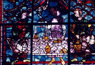MONEYCHANGERS Members of the moneychangers guild: stained glass window, 13th century, Chartres Cathedral.