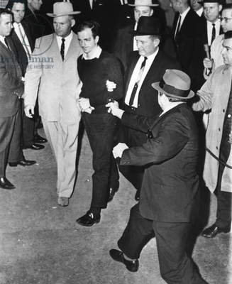 LEE HARVEY OSWALD (1930-1963). Presumed assassin of President John F. Kennedy. The fatal shooting of Oswald by nightclub proprietor Jack Ruby at the Dallas, Texas police headquarters, 24 November 1963.