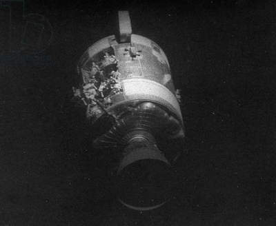 APOLLO 13, 1970 View of the damaged Apollo 13 Service Module after being jettisoned from the Lunar/Command Modules. Photograph, 1970.