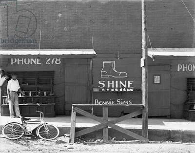 BOOTBLACK STAND, 1936 A shoeshine stand in the southeast. Photograph by Walker Evans in 1936.