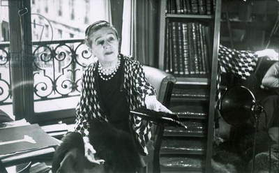 JEANNE LANVIN (1867-1946) French fashion designer. Photographed in her office at the House of Lanvin in Paris, 1937.