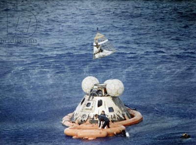 APOLLO 13, 1970 Astronauts being lifted from the Apollo 13 spacecraft after splashdown in the South Pacific. Photograph, 1970.