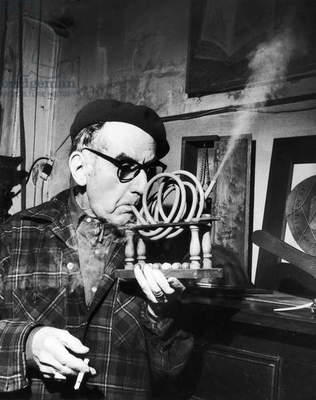 MAN RAY (1890-1976) Originally Emmanuel Rudnitsky. American painter, photographer and filmmaker. Man Ray demonstrating his 'Smoking Device,' 1964.