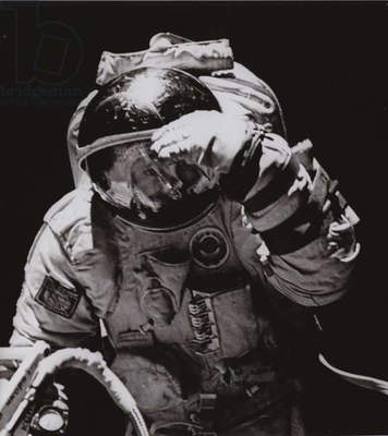 Pilot-Cosmonaut of the USSR Leonid Kizim, twice a Hero of the Soviet Union, performing a space walk (b/w photo)
