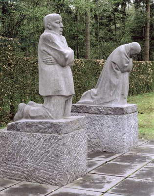 Memorial depicting the artist and her husband mourning their dead son, Peter Kollwitz, dedicated in 1931 (stone)